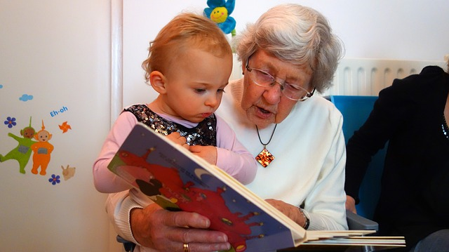 The elderly reading to the young