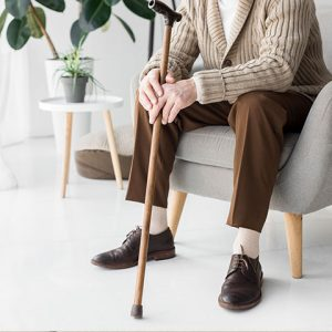 Elderly man with a cane