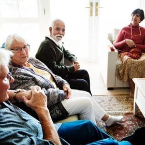 Elders meeting in assisted living facility